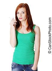 Teen girl holding cigarette.