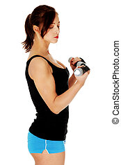 Teen girl holding dumbbells.