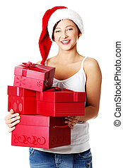 Teen girl holding gifts.