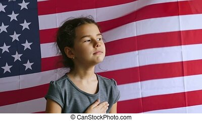 teen girl holding hands on the usa heart Independence Day American flag Fourth of July