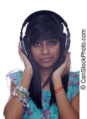Teen Girl Holding Headphones