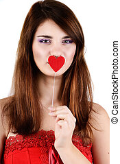 teen girl holding heart near her mouth