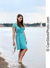teen girl holding sandals