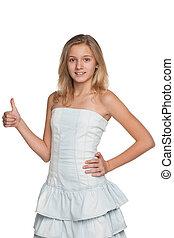 Teen girl holds her thumb up