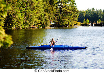 teen girl in a kayak on the lake
