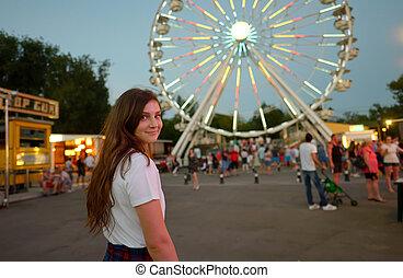 Teen girl in amusement park