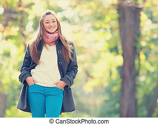 Teen girl in autumn outdoor