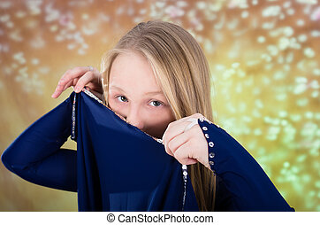 Teen girl in blue dance costume