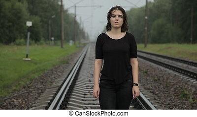 Teen girl in depression on the railway