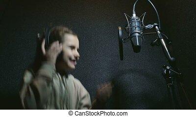 teen girl in headphones singing into microphone audio professional studio music