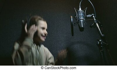 teen girl in headphones singing into microphone audio professional studio music