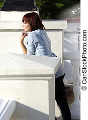 teen girl in leggings standing on ballustrade
