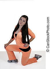 Teen Girl in Orange Exercise Outfit Kneeling