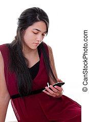 Teen girl in red dress holding cellphone