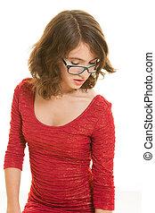 Teen girl in red looking down