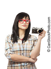 Teen girl in red with camera at white background