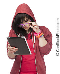 Teen girl in red with tablet at white background.