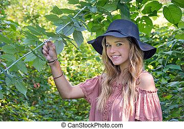 teen girl in summer woods