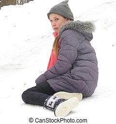 Teen girl in the park on a snow