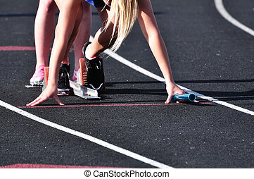 Teen Girl in the Starting Blocks at a Track Meet