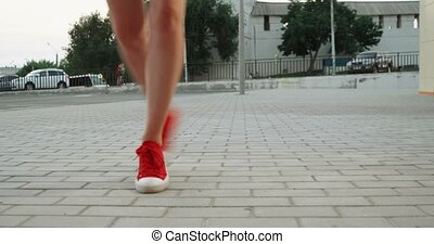 Teen Girl in trainers having fun running about