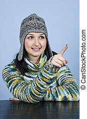 Teen girl in winter clothes pointing
