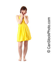 Teen girl in yellow summer dress