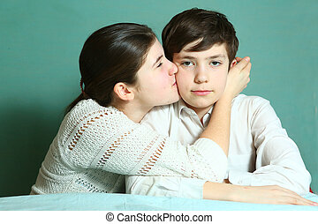 teen girl kiss brother close up portrait