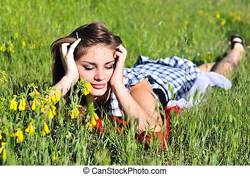 teen girl laying on the meadow