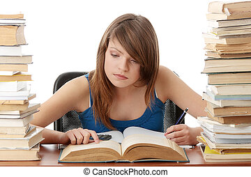 Teen girl learning at the desk with lot of books, isolated...