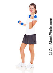 teen girl lifting dumbbells