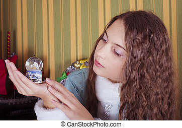 teen girl looking at  snow globe