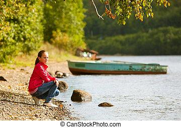 Teen-girl near the river in summer.