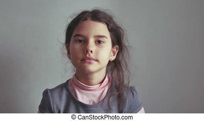 teen girl nods her head yes agreed gesture indoor the...