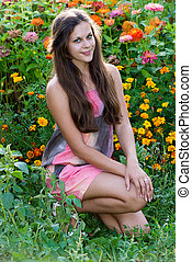 Teen girl on a background of flowers