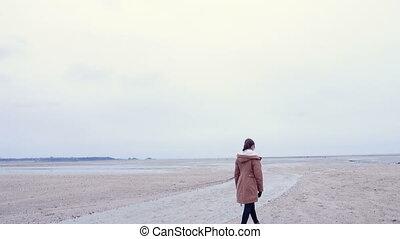 teen girl on an empty beach - teen girl walking on an empty...
