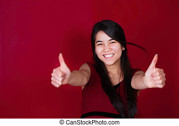 Teen girl on red background with th