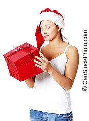 Teen girl opening a gift.