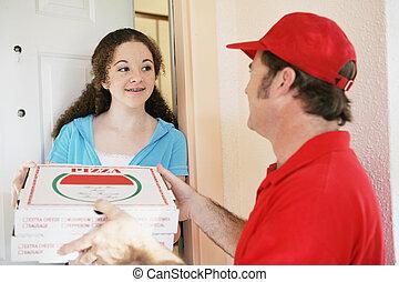 Teen Girl Orders Pizza - Teen girl answering the door to...