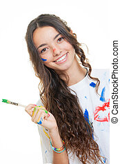 teen girl painting messily