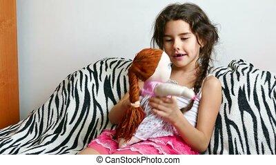 teen girl play with doll  - teen girl  play with doll
