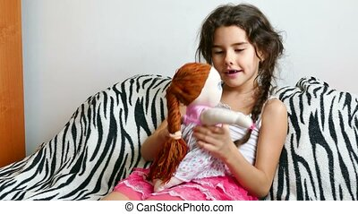 teen girl play with doll  - teen girl  play with doll