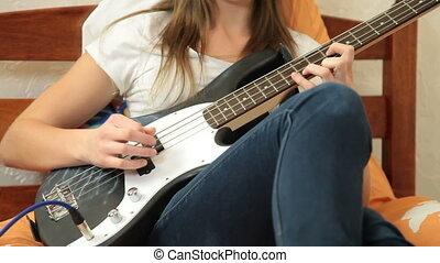 Teen Girl Playing Bass Guitar