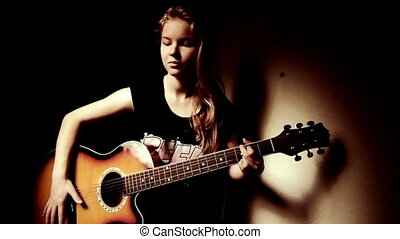 Teen Girl Playing Guitar At Home