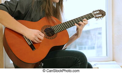 Teen Girl Playing Guitar