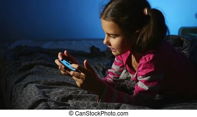 teen girl playing portable video game a console kid at...