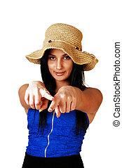 Teen girl pointing finger.