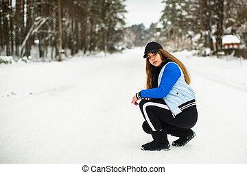 Teen girl portrait of gop-style in the park in snowy winter.