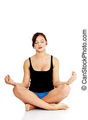 Teen girl practising yoga.