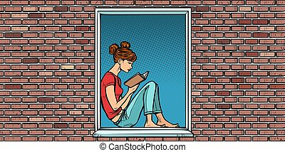 Teen girl reading a book, sitting in the window